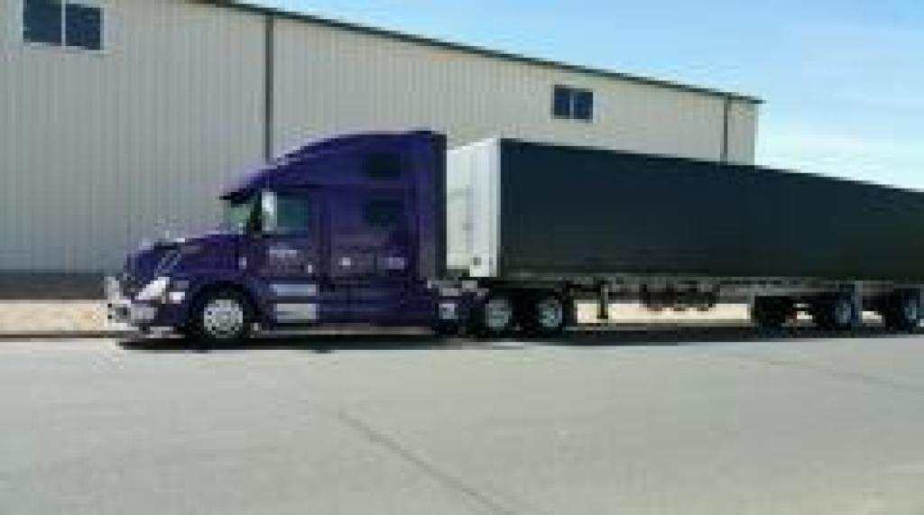 Conestoga semi-truck hauling by Da-Ran Inc, in USA 48 states and parts of canada